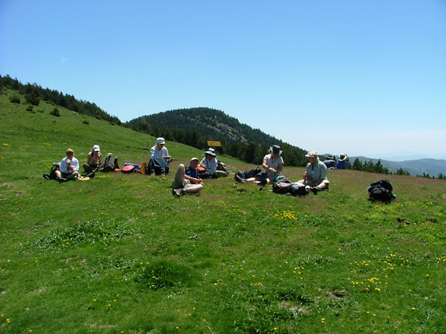 A guided walking group relaxing for lunch